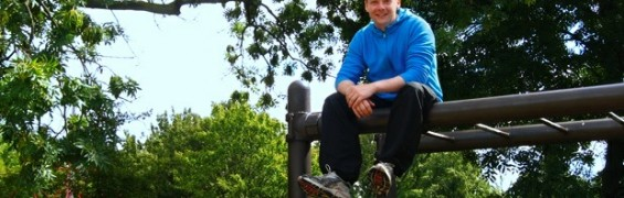London Personal Trainer seated on top of monkey bars