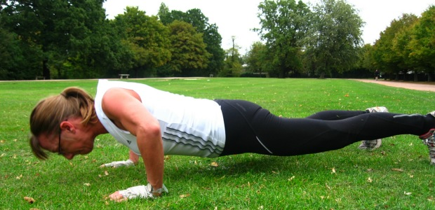 A fit woman in her fifties completing a full push-up
