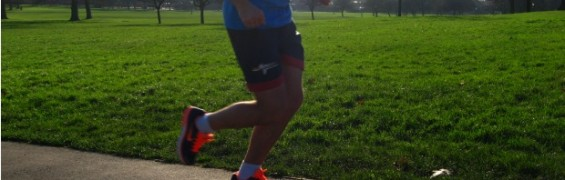 Exercise Gear for man running in wintry park