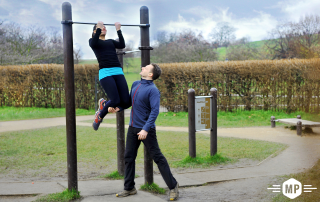 Outdoor fitness, chin up bar demonstration at trim trail