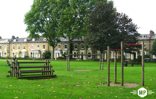 Outdoor fitness using calisthenics exercises on London common ground