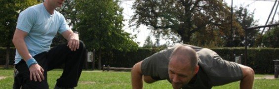 Timed exercise, performing push-ups in the park