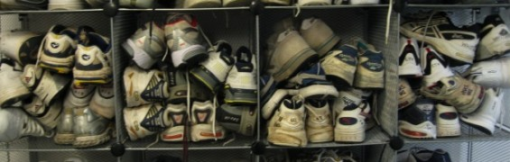 Dozens of pairs of sneakers, crammed into gym lockers