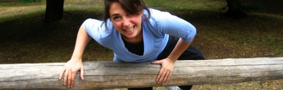 Smiling woman training outdoors in sunshine